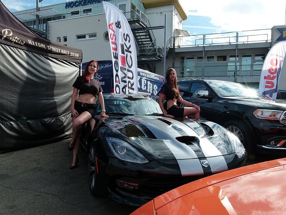 Beautiful girls posing with Dodge Viper