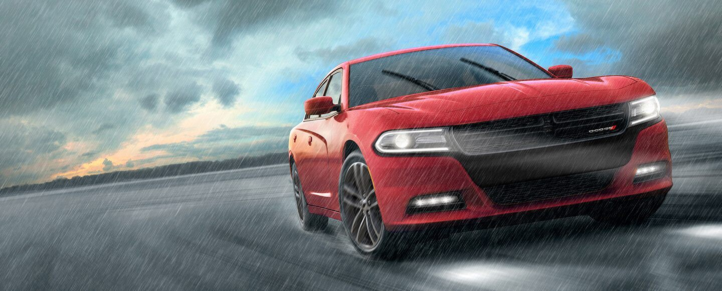 Red Dodge Charger in the rain