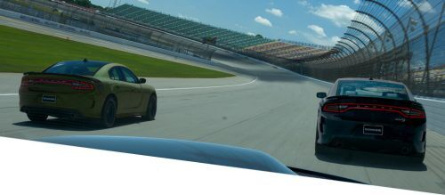 couple of Dodge Charger running on the circuit