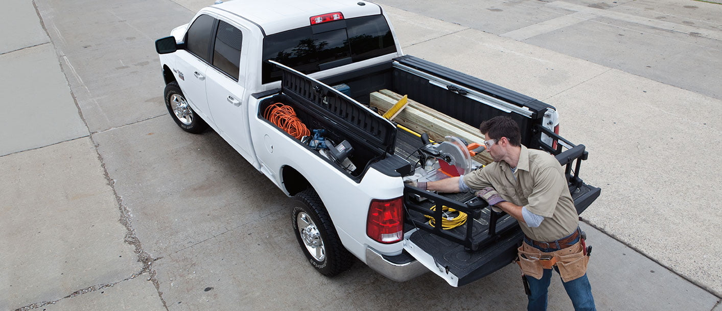 2019 dodge ram 1500 white man loading cargo
