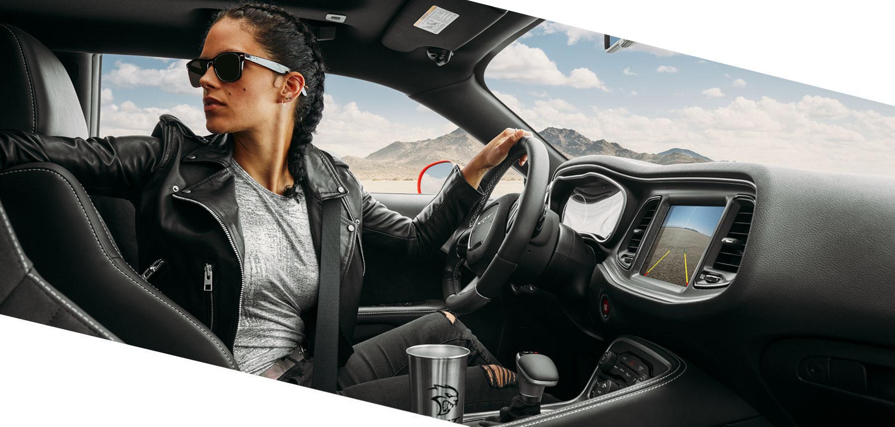 girl driving dodge srt muscle car