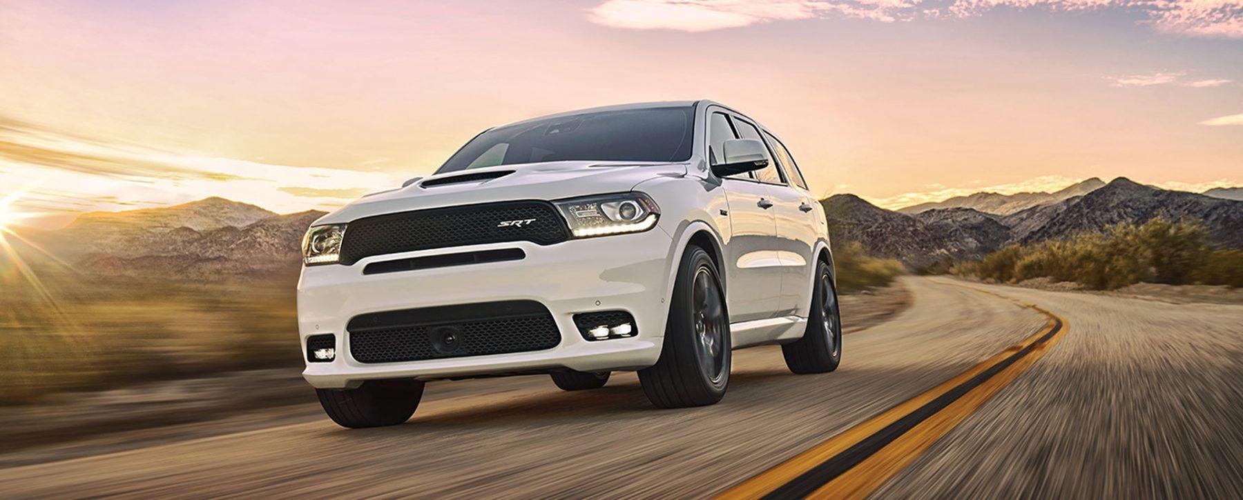 White Dodge Durango SRT runs on the road