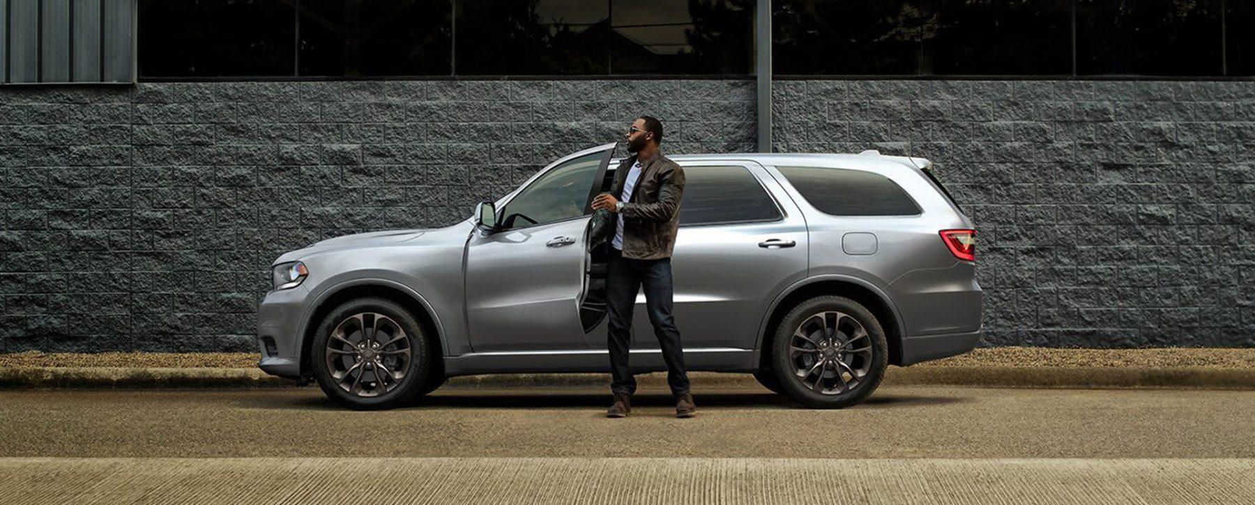 Man in front of Dodge Durango
