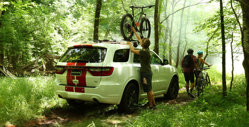 american suv dodge durango in the nature hiking bike