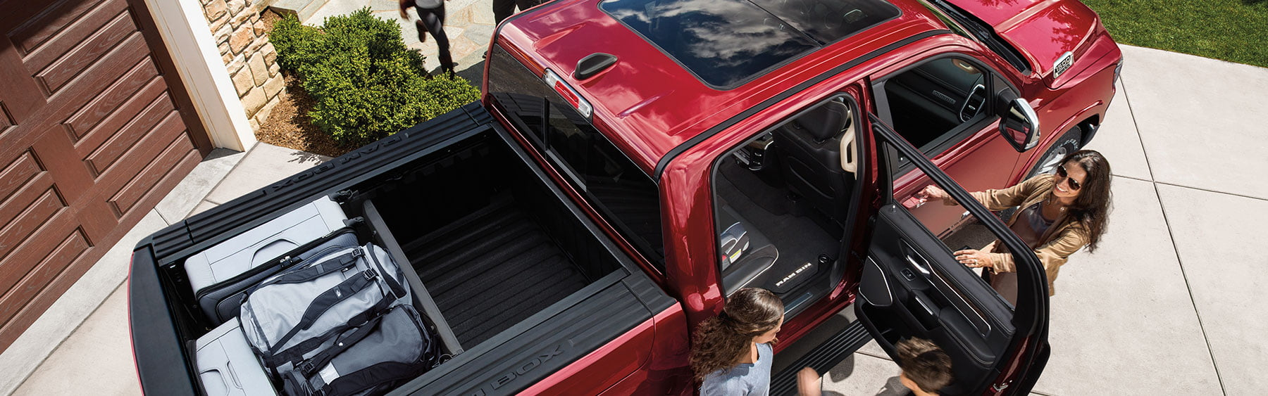 family holidays on ram trucks loading luggage on cargo
